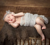 Girl sleeping on a cot — Stock Photo