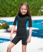 Girl in wetsuit near pool — Stock Photo