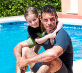Girl with father near pool — Foto de Stock