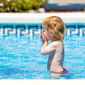 Baby girl in pool — Foto de Stock