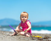 Baby girl on beach — Stock Photo
