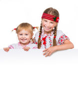 Girls in Ukrainian costumes — Stockfoto