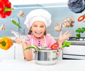 Girl preparing vegetarian soup — Stock Photo