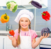 Little girl dressed as cook — Stock Photo