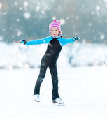 Little girl skating outdoors — Stock Photo