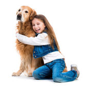Girl with golden retriever — Stok fotoğraf