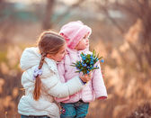 Girls holding bouquet of flowers — Stock Photo
