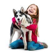 Girl with husky dog — Stock Photo