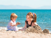 Little girls on beach — Stock Photo