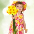 Cute little girl giving yeloow flowers — Stock Photo #5714515