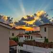 Sunset over holiday beach villas — Stock Photo #33363735