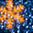 Blurred snowflake and lights background — Stock Photo