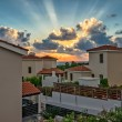 Sunset over holiday beach villas — Stock Photo #43930677
