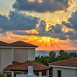 Sunset over holiday beach villas — Stock Photo