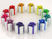White gift boxes with varicolored ribbon — Stock Photo