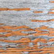 Wooden texture with cracked and peeling paint — Stock Photo