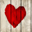 Heart on old wooden wall — Stock Photo