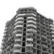 Unfinished high rise building concrete structure - Stock Photo