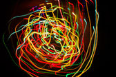 Abstract background with motion glowing lights lines — Stock Photo