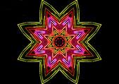 Bright color star on black — Stock Photo