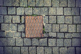 Paving stones background with metal plate — Stock Photo