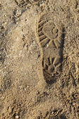 Boot print on the sand — Stok fotoğraf