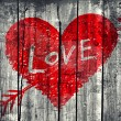 "Drawing of a heart with word ""Love"" on grunge wooden wall backgr — Stock Photo"