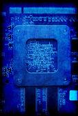 Electronic circuit board blue grunge background — Photo