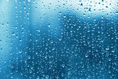 Las gotas de agua sobre el vidrio — Foto de Stock