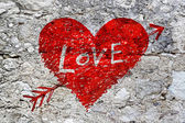 Abstract heart on grunge stone wall texture — Stock Photo