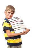School boy is holding books — Stock Photo