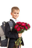 Schoolboy is holding flowers. Back to school — ストック写真