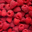 Ripe rasberry fruit horizontal close up background. - Stock Photo