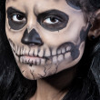 Young woman in day of the dead mask skull. Halloween face art — Stock Photo