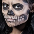 Young woman in day of the dead mask skull. Halloween face art — Stock Photo #12819668