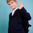 Cute schoolboy show sign hello - Stock Photo