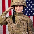Stock Photo: Boy USA soldier saluting in front of American flag.
