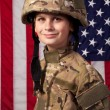 Boy USA soldier in front of American flag. — Stock Photo #13559938
