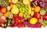 Huge group of fresh fruits isolated on a white background. — Stock Photo