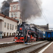 Old steam train is leaving a station — Stockfoto