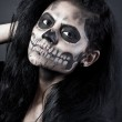 Young woman in day of the dead mask skull. Halloween face art — Stock Photo #13843310