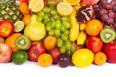 Huge group of fresh fruits isolated on a white — Stock Photo