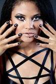 Beautiful woman is showing nails. Fashion portrait. Close-up fac — Stock Photo