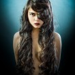 Beautiful brunette Asian woman with long black hair — Stock Photo