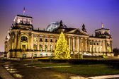 Reichstag in berlin in winter at night with christmas tree — Stock Photo