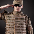 Army soldier saluting - Stock Photo