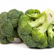 Single broccoli floret isolated on white — Stock Photo