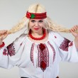 Woman wears Ukrainian national dress - Stock Photo