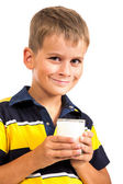Cute boy is drinking milk on white — Stock Photo