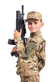 Young boy dressed like a soldier with rifle — Stock Photo